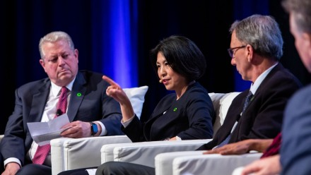 Professor Xuemei Bai on stage with Al Gore