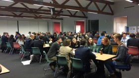 Students in a classroom discus the forestry industry during the 'World Cafe' session.