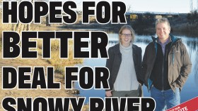 Isobel Bender on front page of The Monaro Post with Prof Jamie Pittock. The two stand together in wintery garments with the river in the background.